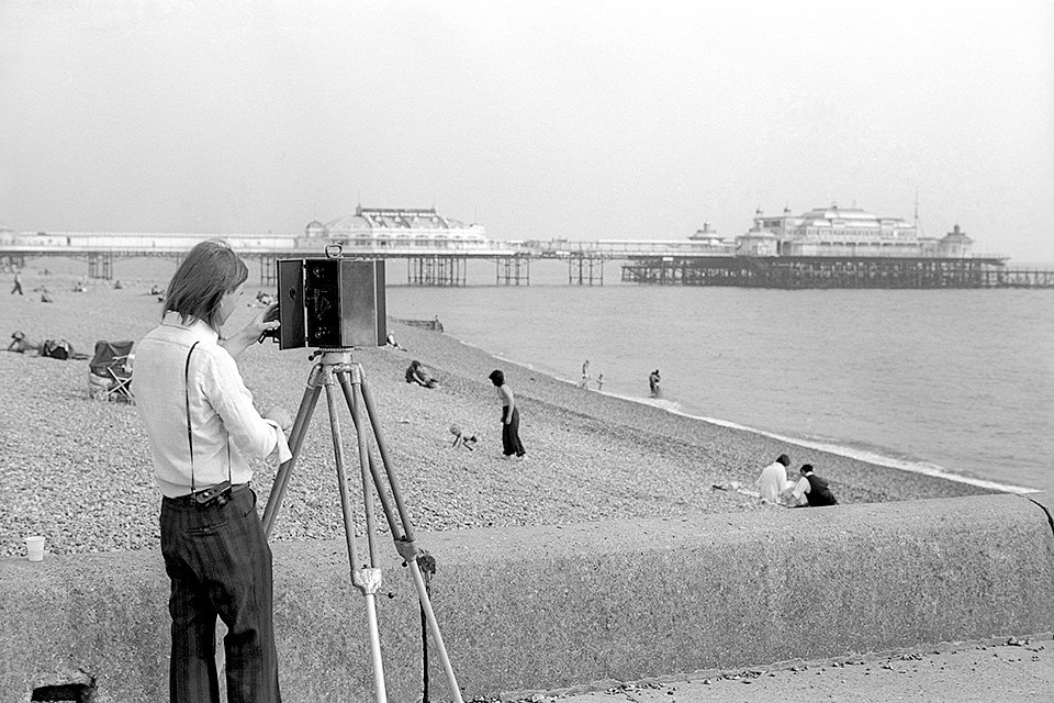 Malcolm Taylor testing the fully restored cine camera on Brighton Beach: Pic-Wilf James