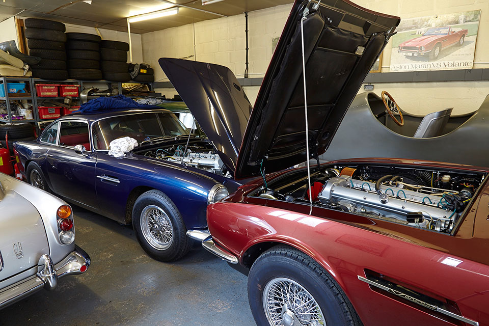 Brace of DB5's & the DBS engine bay. Wide angle to get the most in the frame from a tight space (24mm 1.3sec @ f11)