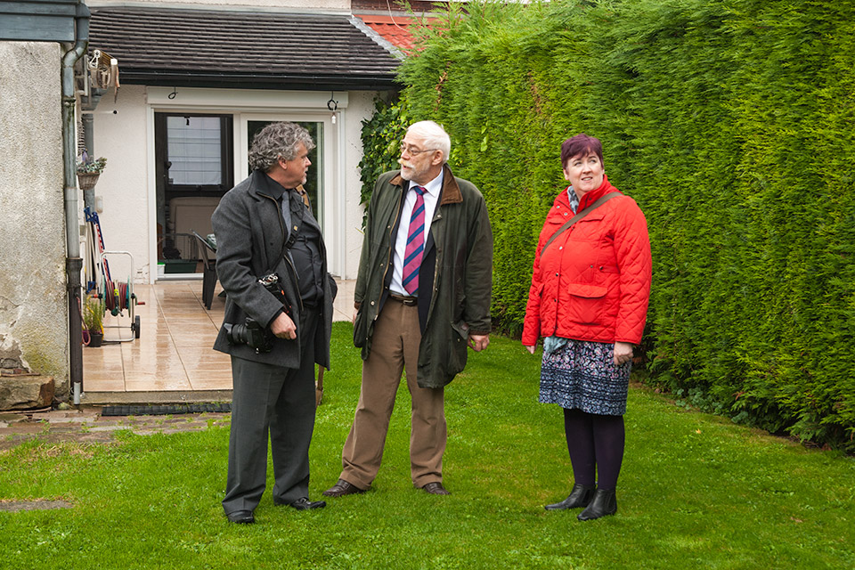 Kathleen and Barry McCann and Dr John Krijnen in the garden where all seven combatants were burried